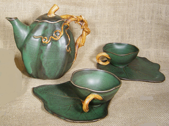 FIREWORKS VINE POTTERY TEA SET - SET OF 4 CUPS AND SAUCERS AND ONE TEAPOT