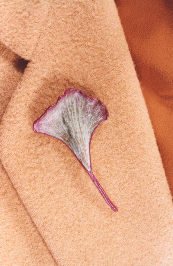 GINKGO PIN ON A CAMEL HAIR BLAZER